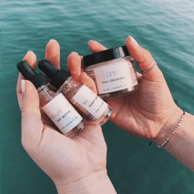 women holding ultimate anti-aging custom trio near water
