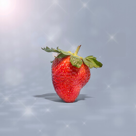 strawberry standing with disco ball lighting