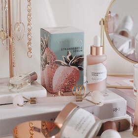 strawberry serum on vanity with skincare products