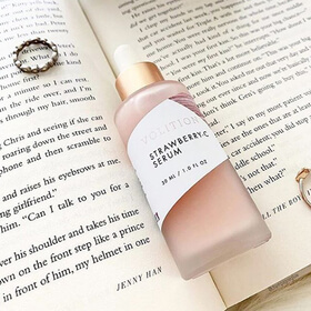 strawberry serum on a book with rings