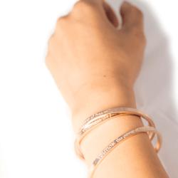 woman wearing rose gold cuff
