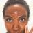 woman wearing turmeric brightening polish