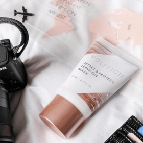 Jetset & Protect Leave-on Mask with makeup bag and camera flatlay