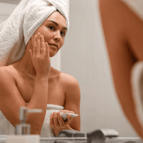 woman applying Jetset & Protect Leave-on Mask