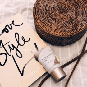 Jetset & Protect Leave-on Mask with book and basket flatlay