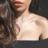 woman with glowing skin wearing Illuminating Body Milk