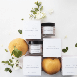 neroli complete creme with oranges and boxes flatlay